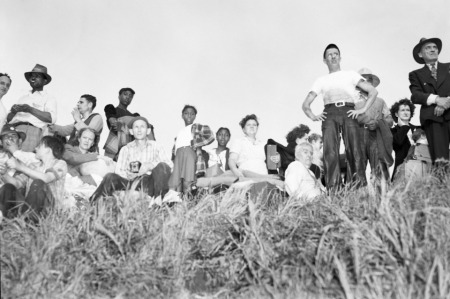 Survivors gather on high ground to watch the destruction of Vanport. May 30, 1948. Photo by Allen deLay (1915-2005) ©Thomas Robinson